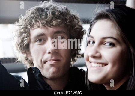 Close-up portrait of happy young couple - Stock Photo