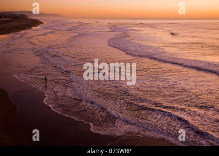 Ocean Beach at sunset well known surfers beach on the Pacific Ocean coast of San Francisco central north California - Stock Photo