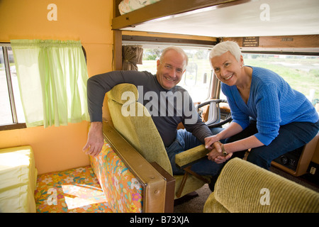 Senior couple inside RV - Stock Photo