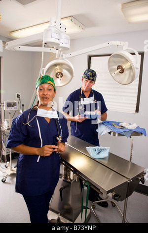 Two veterinarians in empty operating room - Stock Photo