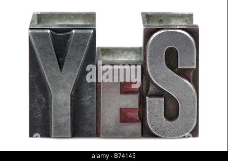 The word Yes in old letterpress printing blocks isolated on a white background - Stock Photo