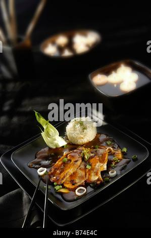Chinese Pork in black bean sauce - Stock Photo