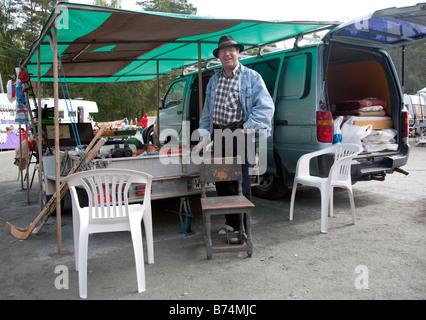 Salesman at Pestuumarkkinat market fair at Rautalampi Finland - Stock Photo