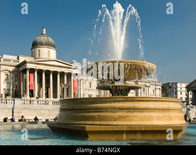 View across the Trafalgar square to the National Gallery, London, UK - Stock Photo
