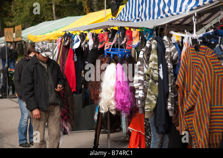 Clothes seller and his stall at Pestuumarkkinat market fair, Rautalampi, Finland - Stock Photo