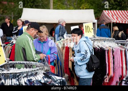 People buying clothes in Pestuumarkkinat market fair, Rautalampi, Finland - Stock Photo