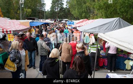 People at in Finnish Pestuumarkkinat market fair in Rautalampi Finland - Stock Photo