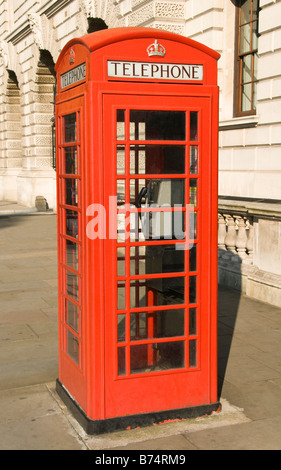 Traditional telephone box in the City of Westminster, London, UK - Stock Photo