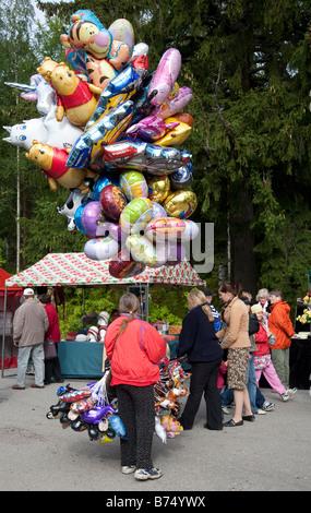 Balloon salesperson at Pestuumarkkinat market fair, Rautalampi, Finland - Stock Photo