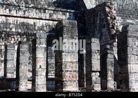Stone relief carving pillars in front of Temple of Warriors in Chichen Itza Mexico - Stock Photo