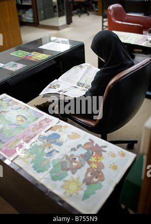 Pakistan Student at a library in Islamabad Pakistan - Stock Photo