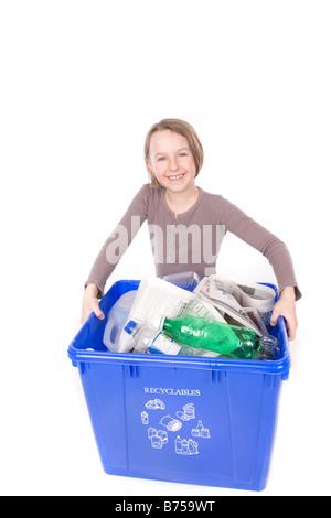 Girl carrying recycling box, Winnipeg, Manitoba - Stock Photo