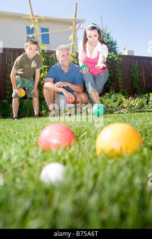 Family play bocce ball in backyard, Winnipeg, Manitoba, Canada - Stock Photo