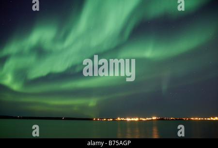Dramatic aurora borealis, Great Slave Lake, Northwest Territories, Canada - Stock Photo