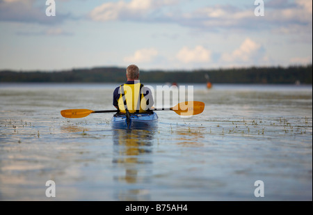 Kayaking on Back Bay, Great Slave Lake in Yellowknife, Northwest Territories, Canada - Stock Photo