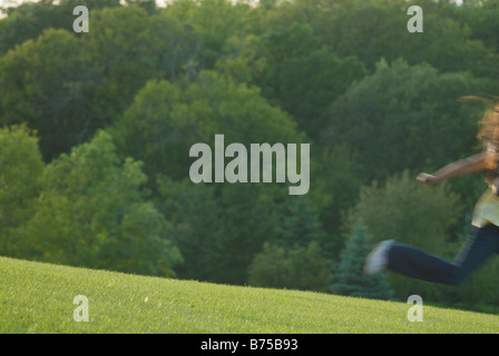 Eight year old girl running, blurred, Winnipeg, Canada - Stock Photo