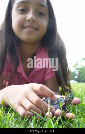 Eight year old girl holding turtle, Winnipeg, Canada - Stock Photo