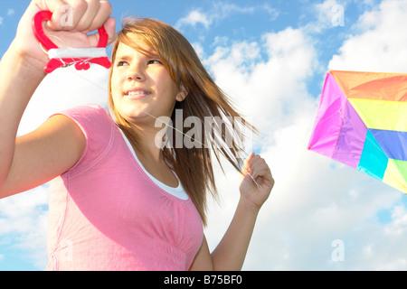 Thirteen year old girl with kite, Winnipeg, Canada - Stock Photo