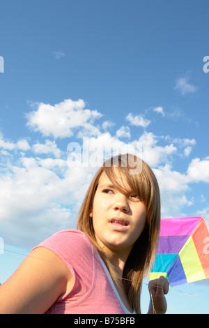 Thirteen year old girl with kite, Winnipeg, Manitoba, Canada - Stock Photo