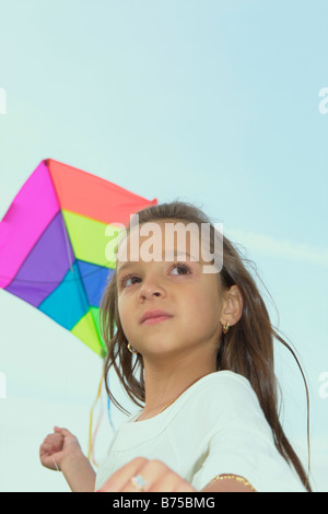 Seven year old girl with kite, Winnipeg, Canada - Stock Photo