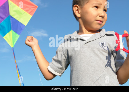 Six year old boy with kite, Winnipeg, Canada - Stock Photo
