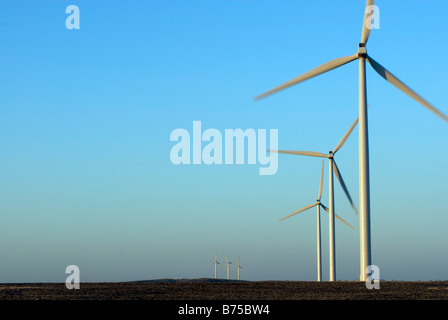 Three wind turbines in foreground, three wind turbines in background - Stock Photo