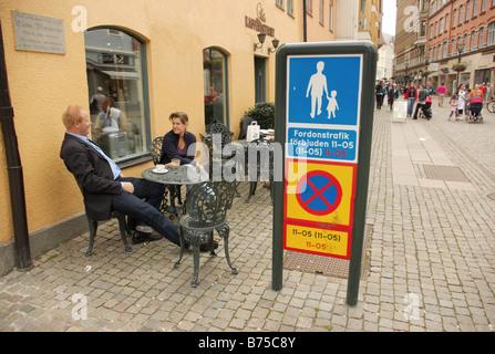 Outdoor cafe on a pedestrianized street, Malmo, Sweden - Stock Photo