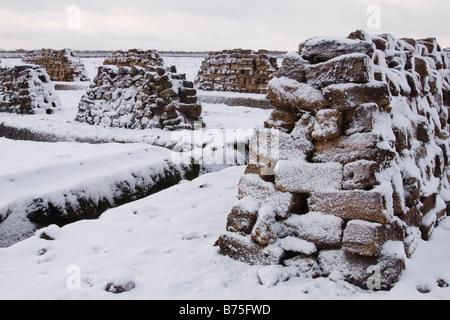 peat in the moor snowed under   winter in the moor - Stock Photo