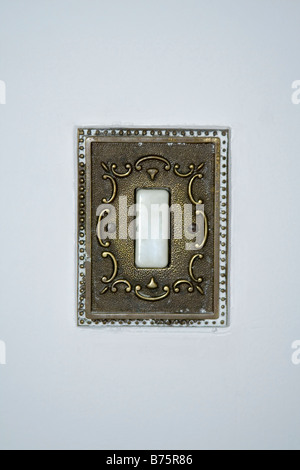 Old style light switch on a white wall. - Stock Photo