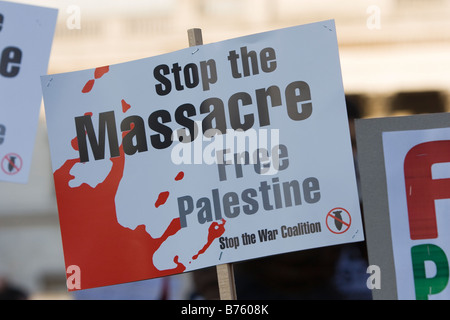 Palestinian demonstrators in London s Trafalgar Square along with estimated 50 000 marchers against Israel s bombing - Stock Photo