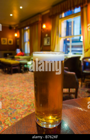 Pint of bitter in White Horse pub in Soho in central London England UK - Stock Photo