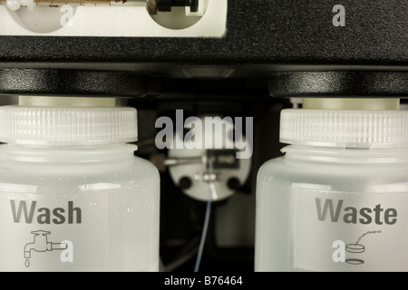 Wash and waste collection vessels for atomic absorption autosampler, - Stock Photo