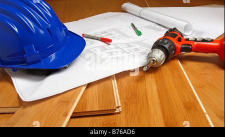 fine image of blue helmet drill blueprint on wood background - Stock Photo