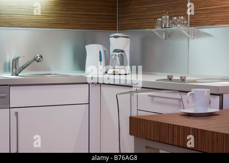 Modern White Interior Kitchen Design Corner With Electrical Appliances Table Chair Mug