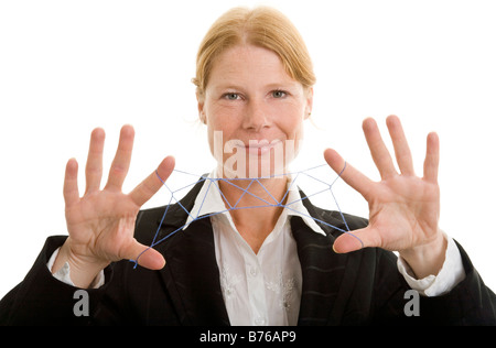 Redhead Female Boss pull the strings - Stock Photo