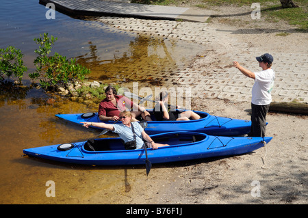 J N Ding Darling national wildlife refuge sanibel island florida couple prepare to out canoeing - Stock Photo