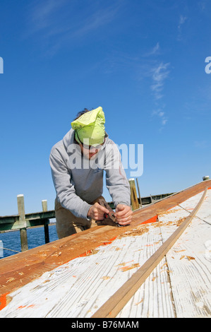 Restoration of the Skipjack Caleb W. Jones at the Chesapeake Bay Maritime Museum in St Michael's Maryland USA - Stock Photo