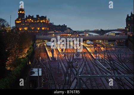 Edinburgh's Waverley Station and Balmoral Hotel in Winter - Stock Photo