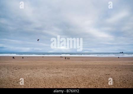People on beach at Longsands Tynemouth UK - Stock Photo