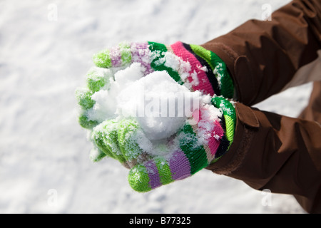 close up of woman holding snowball Copy space - Stock Photo