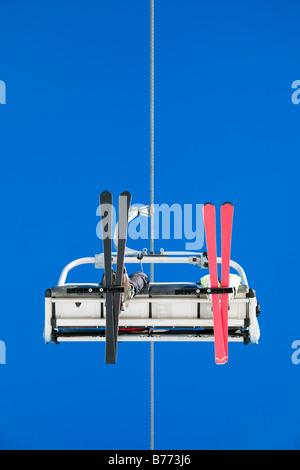 couple on ski lift Low angle view - Stock Photo
