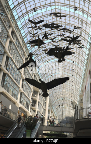 Michael Snow's Geese fly overhead at Toronto's Eaton Centre - Stock Photo