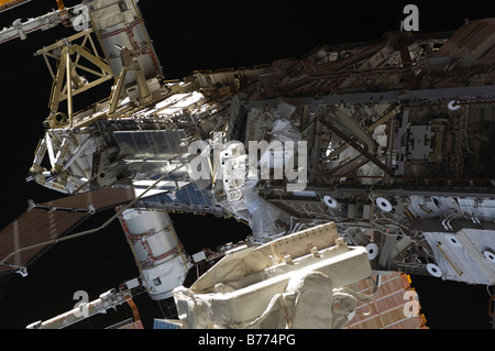 Astronaut participates in extravehicular activity. - Stock Photo