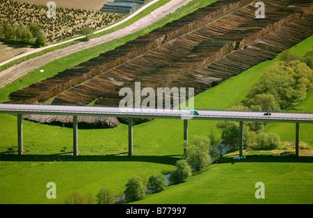 Aerial photo, bridge, wet-store for hurricane Kyrill wood, Meschede Bestwig, Hochsauerland district, North Rhine - Stock Photo