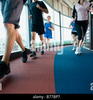 Runners on indoor track - Stock Photo