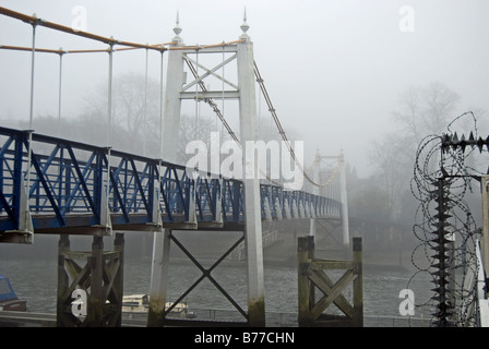 teddington bridge on the river thames in southwest london, seen from the east side on a foggy day - Stock Photo