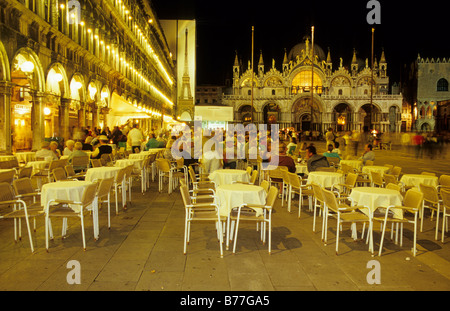 Cafe on St. Mark's Square with St. Mark's Basilica, Venice, Italy, Europe - Stock Photo