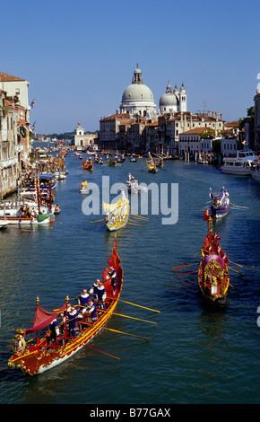 Regatta storica on Canal Grande with Basilica di Santa Maria della Salute, Venice, Italy, Europe - Stock Photo