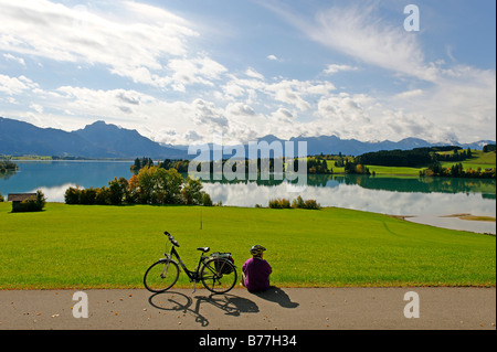 Forggensee lake in front of the Saeuling mountain, 2047 m, and the mountains of Thannheim, Bavarian Swabia, Bavaria, - Stock Photo