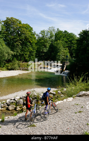 Cyclists at the Traun River near Siegsdorf, Chiemgau, Upper Bavaria, Germany, Europe - Stock Photo
